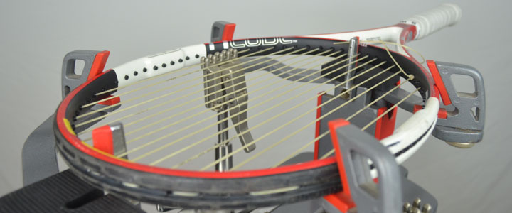 A photograph of a tennis racquet halfway stung with Tecnfibire X-One Biphase.