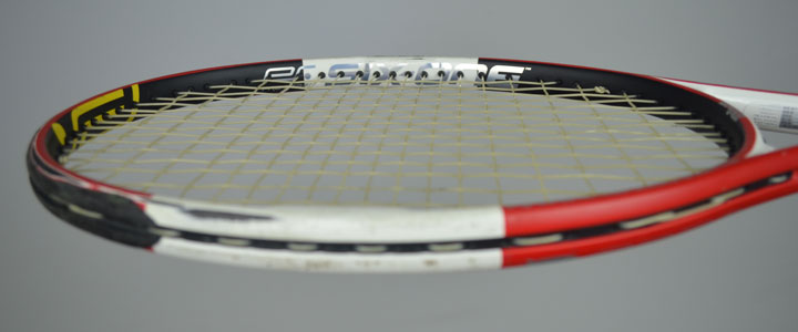 A photograph of a tennis racquet strung with Tecnifibre X-One Biphase from the side.