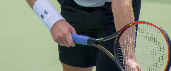 A close up photograph of Andy Murray's tennis serve grip.