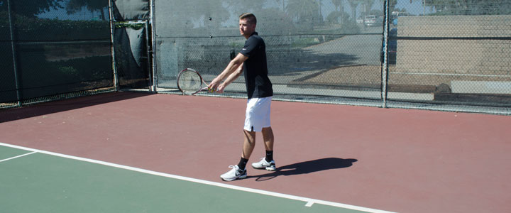 A photograph showing the proper tennis serve stance