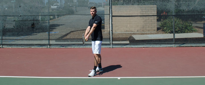 A photograph showing the tennis serve stance ready position.