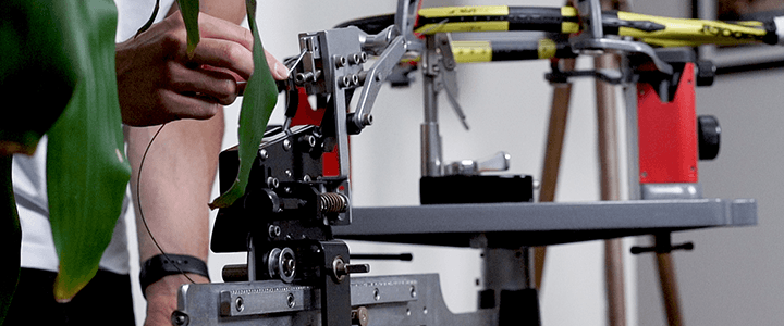 Tennis String Tension Explained: Pulling Tension on a Stringing Machine